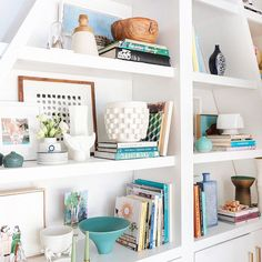 One of my least favorite things to do: destroy my house by styling these shelves. One of my favorite things to do: look at pretty photos of these styled shelves. We restyled them again 3 different ways (different than this) coming soon to a blog near you.  @tessaneustadt