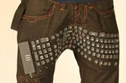 Keyboard pants with wireless mouse and speakers