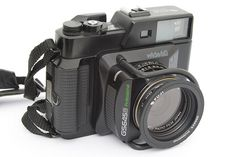 The Fuji GS645 series of compact rangefinders was available with fixed lenses of…