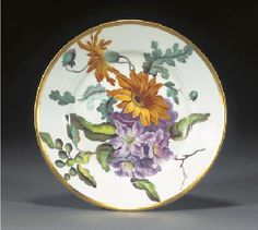 A Derby botanical plate Circa 1815, iron-red crown, crossed batons and D mark, gilder's mark 2 for James Clark Painted by William 'Quaker' Pegg with a spray of Shrubby Viper Buglas, & Orange Arctotis, titled to the reverse in iron-red script, below a broad gilt band early Factory Derbyshire