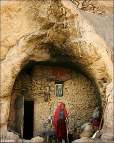 Cave house - A woman from the ethnic Hazara minority stands in front of her cave home in Bamiyan, some 240 km (150 miles) northwest of Kabul.
