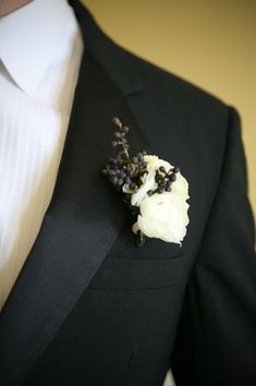 Kind of formal for us, but I love how simple and elegant it is. Boutonnieres for the Boys Wedding Flowers Photos on WeddingWire