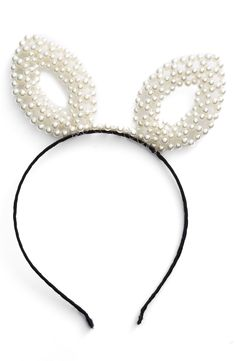 Pearly-beaded bunny ears for a look that's both pretty and playful.
