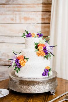 Having an orange and purple wedding can be tricky, but this summer wedding did it flawlessly. The bride stunned in a sweetheart neckline dress with lace overlay, and the white barn was the perfect backdrop. Summer Wedding Cakes, Purple Wedding Cakes, Gold Wedding, Wedding Reception, Dream Wedding, Orange Purple Wedding, Orange And Purple, Orange Dress, Wedding Cake Designs