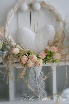Pretty soft wreath for spring - twine, raffia, pink roses absolutely love this !