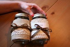 "The basic part is wrapping the burlap and lace around the jars.   So, get your jars ready (we used medium-sized canning jars) and cut strips the width you want them, long enough to go around the jar with a 1"" overlap at the back.  (You could also make some super cute ones of these with vintage-ey quilting fabric, or any fabric or ribbon!)"