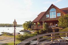 The Brewster Academy in Wolfeboro, NH is the perfect venue for a DIY reception on the water.  This venue has a lovely wrap around porch, and a gorgeous lakeside spot for a wedding ceremony...  #brewsteracademy #nhweddingphotography #dreamlovephotography
