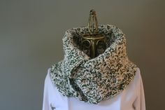 """leigh"" buttoned cowl: super warm, super soft buttoned cowl is crocheted in a distinctive & versatile color combination - asparagus green & creamy off white. this cowl is so easy to wear. no pulling over your head and mussing your hair. simply wrap around your neck and button it as loosely or tightly as you want. fold over the excess above the buttons as high or low as you want. or button it unevenly to create an asymmetrical look!"