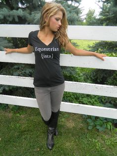 """""""In order to be irreplaceable, one must always be different."""" Decorated in our studio - our trademarked signature line is truly original! This deep V-neck tee is feminine style, wrapped in laid back c"""
