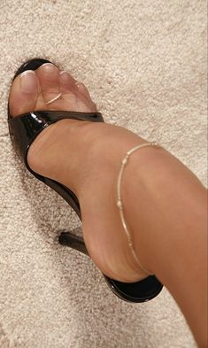 Pretty toes in sheer reinforced toe nylons and sexy mules. #highheelsstockings