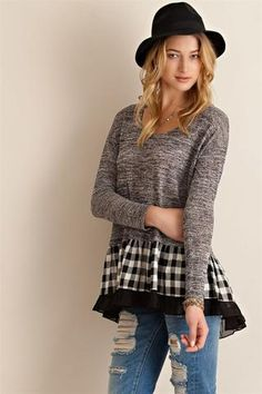 Melange cut and sew sweater top featuring plaid ruffle detail on hem. partially see-through. Unlined. Knit. Lightweight. - 50% Rayon - 50% Polyester