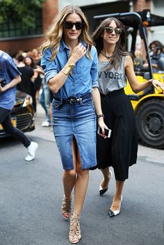 Olivia Palermo wearing a belted denim pencil skirt with front slit, a chambray shirt, and strappy nude heels