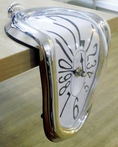 Shelve clock, Melting Clock by Close Up, http://www.amazon.ca/dp/B00COB4RF2/ref=cm_sw_r_pi_dp_bQtvtb1P189D2