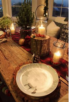 Love the use of ball jars with candles and the logs.
