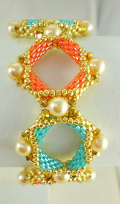 Square Shape Geometrical Bracelet Beadwoven Beaded Beadwork Colorful Multi Colored Blue Orange White swarovski ab crystal, seed beads, fireline tread, swarovski pearls Love the colours!