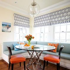 corner-storage-bench-and-corner-booth-kitchen-table-for-kitchen-banquette-with-dining-chairs-also-glass-pendant-lighting-and-window-shades-with-single-hung-windows-plus-ikat-pillows