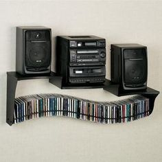 Wall Mount Stereo Shelf and CD Holder - Perfect idea with so little room in our bedroom - both his and my choice.