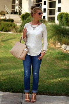 white top long sleeve, silver necklace, light colored skinny's, gold watch