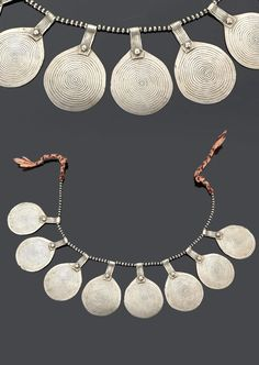 Morocco - Anti Atlas region, Ahl-Massa, Aït Ba Amra | Necklace; eight silver pendants with spiral design, interspersed with silver and black stone beads on cotton cord | Sold ~ (May '15)