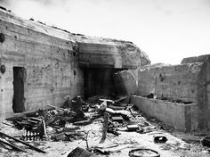 This concrete pillbox, one of the many fortifications in the German coastal defences, was damaged when captured by American troops, Utah, Beach, August 2, 1944