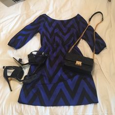 Chevron Boutique Dress This blue and black chevron dress is from a Boutique in Lexington, KY called the Bluetique. It's only been worn a couple times and in perfect condition. The brand is Everly and the material is satin. There is a blue liner and it's a very cute dress!                                                The black Steve Madden pumps are also listed in my closet if you want to check those out and bundle! Everly Dresses Mini