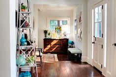 The trim is Dunn Edwards Whisper and the wall color is Benjamin Moore Cloud Nine.
