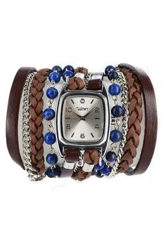 These unique watches incorporate everything you need to spice up your outfits. From leather cords to beads to chain link bracelets, the all-in-one watch design creates a series of stacked bracelets hugging a chic timepiece. We love it for dressing up the LBD or adding some funky flavor to your favorite jeans and tank. Stone: Lapis Lazuli Colors: Blue, brown and silver Materials: Genuine leather, Metal chain links watch Face: Silver overlay Movement: Japanese Quartz Water resistant: 1 ATM…