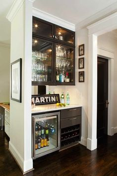 Custom bar design with built in mini refrigerator and mirrored backing. Would be great in the basement