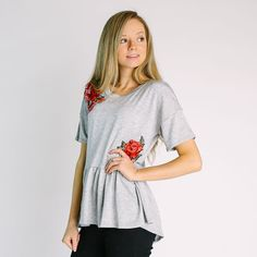 "Soft knit peplum top with floral detail  Approximate bust measurement:  Small - 36""            Medium - 38""            Large - 40""  Approximate length:  Small - 25.5""  Medium - 26""  Large - 26.5""  Fabric content:  Rayon, Polyester, Spandex"