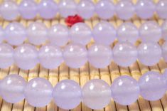 47 pcs of Purple Jade smooth round beads in 8mm