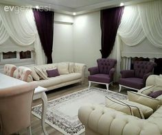 In his new house, Macide has a bright and elegant atmosphere. White Chesterfield armchairs are complemented with purple accents to create a glamorous look. Accessories and textiles . Living Room Themes, Living Room Paint, Living Room Designs, Home Design Decor, House Design, Interior Design, Home Decor, White Armchair, Cool Curtains