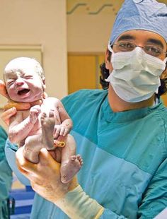 C-section photo essay.  See a c-section of twins from start to finish.