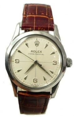 VINTAGE ROLEX PERPETUAL STAINLESS STEEL WATCH CIRCA 1950s