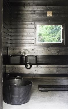Some type of gray or black stained pine. Gives the sauna a Driftwood look