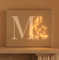 Love this! - Mr & Mrs Light Up Canvas. You can easily DIY with some LED string lights! #FBL http://www.flashingblinkylights.com/amber-led-wire-string-lights-battery-operated.html