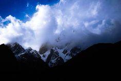 Amazing View of Lady Finger Peak behind clouds, Hunza, Pakistan
