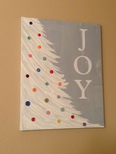 "i created this based on a pinterest post... paint canvas, brush in tree, cricut the JOY letters, and glued on buttons, and then clear coat with modpodge... love this! the original pin of instructions is on my ""a very merry CHRISTmas"" board"
