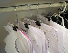 Organizing your sewing patterns -- using hangers and clips!  Another idea -- shipping envelopes, with a picture of the finished product taped or printed on the front.