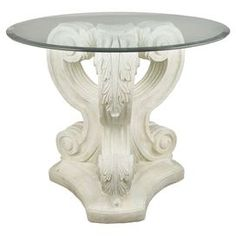 "Indoor/outdoor pedestal side table with a scrolling acanthus leaf base. Handmade in the USA.  Product: Side tableConstruction Material: Fiber stone and glassColor: Distressed whiteFeatures:  Handmade in the USASuitable for indoor or outdoor use Dimensions: 29"" H x 22"" Diameter"