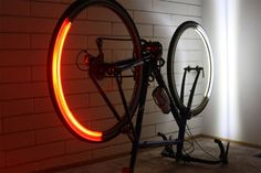 Revolights are a set of thin profile LED rings that you can attach to your bicycle rim to simulate a flashing LED light display. They are smart lights that always point forward and back to light your path.