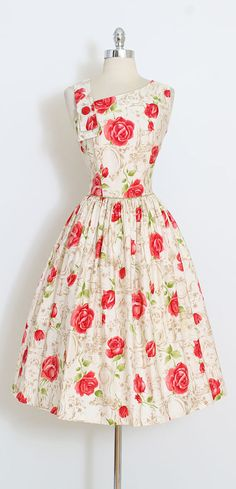➳ vintage 1950s dress * gorgeous brushed cotton * red roses over a background of framed mirrors and clocks * red button accent at shoulder * back zipper * by Nelly Don condition | great - needle tracks at top of each shoulder where an alteration was restored fits like medium length 44 bodice length 18 bust 38 waist 28 hem allowance 4 some clothes may be clipped on dress form to show best fit for appropriate size. ➳ shop http://www.etsy.com/shop/millstreetvintage?ref&...