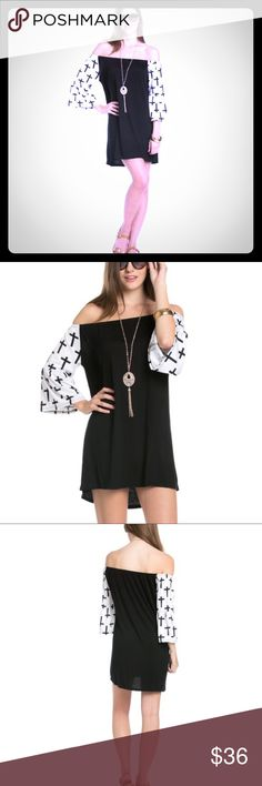 Off the Shoulder Dress Black and White off the Shoulder Dress. Half bell sleeves. Printed crosses with contrast black body. Dresses Mini