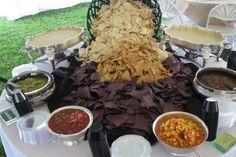 Watch your guests dig into this lavish nacho bar. Margarita, anyone?