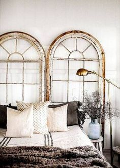 A worn vintage window makes for a super enviable headboard