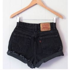 """Vintage Levi's High Waisted Cut Off Denim Shorts Size: 24 *SIZE NOTE* Bought from an ebay seller who measures in the following manner: """"24"""" is the actual waist measurement doubled and not the tag size (12"""" across the very top of the waist). """"To know if these will fit, please measure a pair you own the way we do in the photos.""""  Color: Black  Worn: Never but vintage/reconstructed  Description: • Reconstructed vintage levi's • High-waisted style • Worn cuffed or uncuffed • Great for festivals…"""
