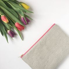 Ecofriendly British woven hemp pouch lined with Cloud 9s Plumes lavender 100% organic cotton fabric. Great for using as a handbag organiser or on its own as a clutch.  • British woven hemp/organic cotton outer fabric  • Cloud 9s Plumes Lavender 100% organ
