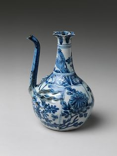 Pouring Vessel (Kendi) with Flowers and Birds Period: Ming dynasty (1368–1644), Wanli period (1573–1620) Date: late 16th–early 17th century Culture: China Medium: Porcelain with applied decoration painted with cobalt blue under transparent glaze (Jingdezhen ware)