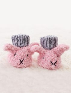 Itty Bitty Fuzzy Wuzzy Bunny Booties in Bernat Softee Baby Solids, the perfect project to keep your little ones cozy! Find this free pattern at LoveKnitting.Com.