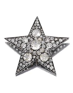 DIAMOND BROOCH, 1880S Designed as a five-pointed star, set with circular-, single-, rose-cut and cushion-shaped diamonds, detachable brooch fitting, two pendant loops.