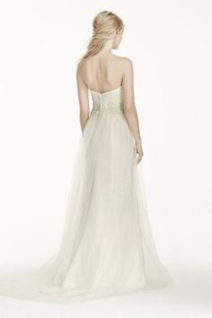 This gorgeous tulle-over-lace sheath gown will make a lasting statement!  Strapless gown features cage skirt and elegant sweetheart neckline.  Tulle-over-lace creates delicate texture all over gown.  Sweep train. Sizes 0-14.  Available in Ivory and White in store and online.  Fully lined. Imported polyester. Back zipper. Dry clean only.  Woman: Style 9WG3750. Sizes 16W- 26W.  Available in store and online.  Extra Length: Style 4XLWG3750. Sizes 0-14.  Extra Length